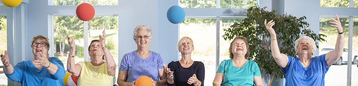 retirees exercising/playing with colorful balls
